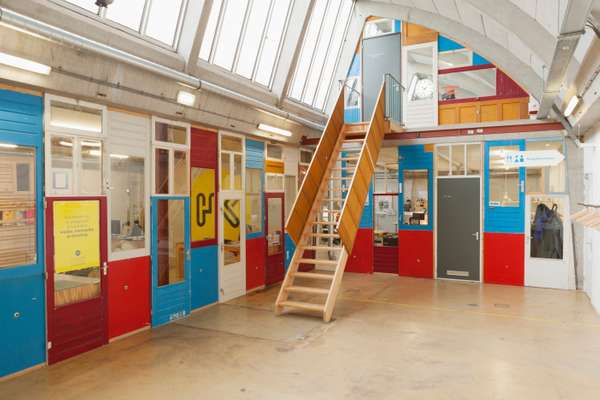 Partitions are fashioned from reclaimed doors