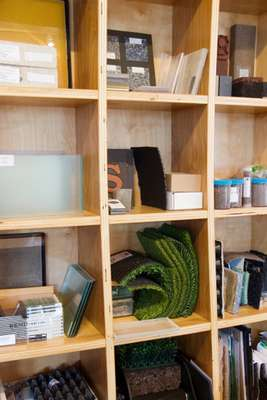 Balmori's offices are lined with shelves containing samples of working materials