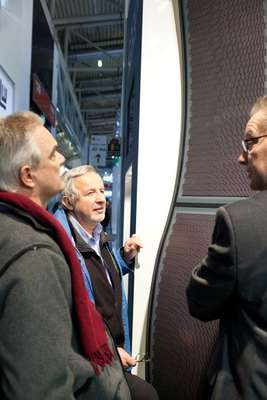 Architects examine photovoltaic panels at Boehme Systems stand
