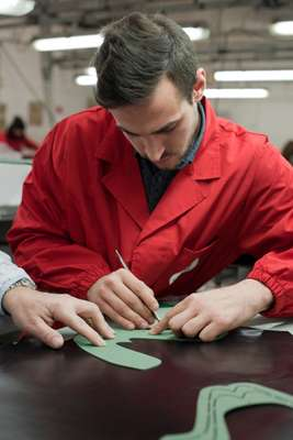 Valle cuts a calf leather for a shoe's upper