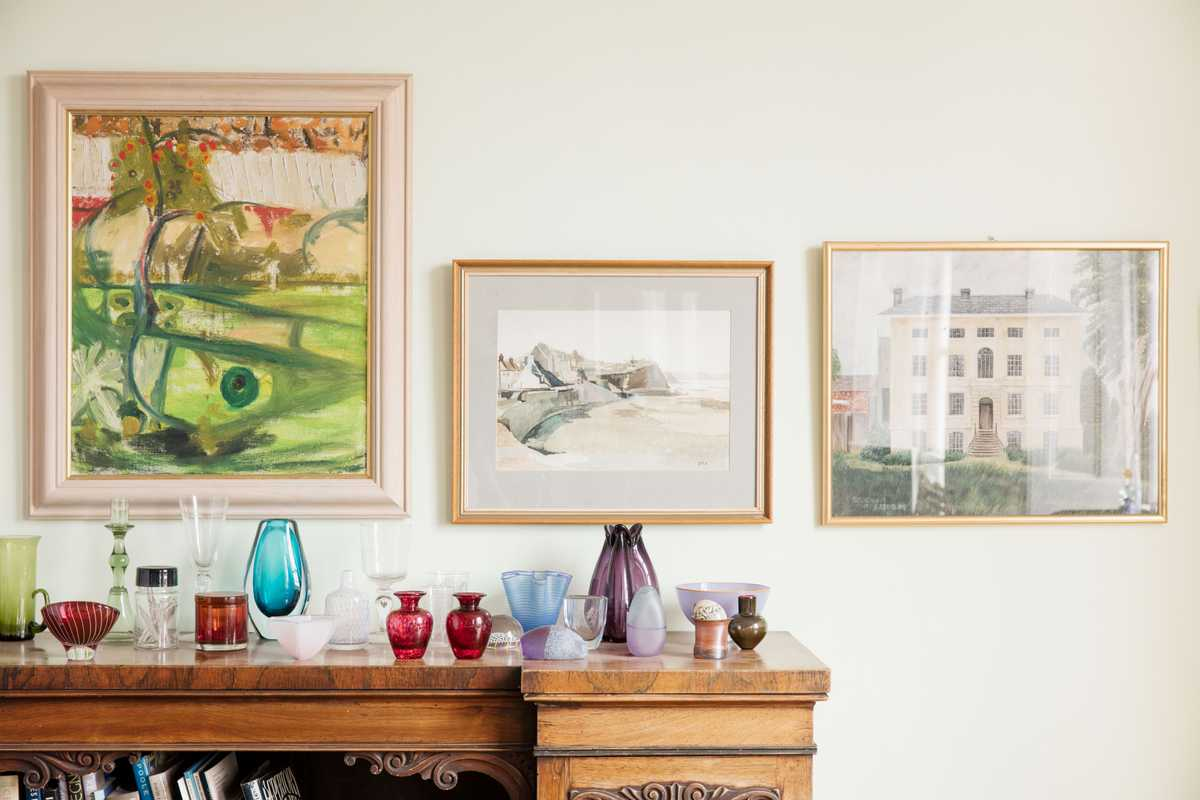 Paintings and glassware in the  middle-floor sitting room