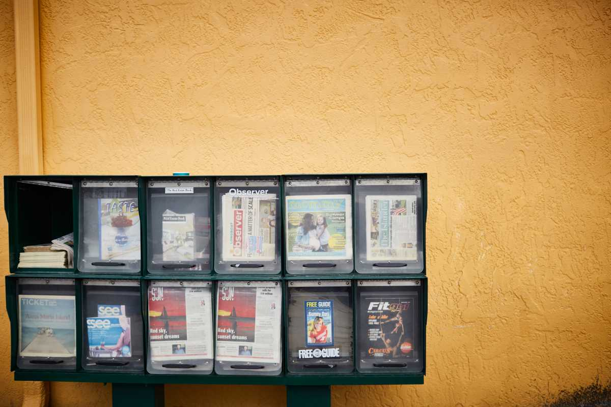 Newstand outside a strip mall