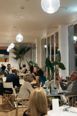 Guests enjoying dinner in the restaurant