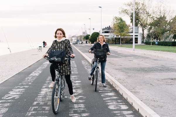 French tourists enjoyng the cycle lane near the Maat museum