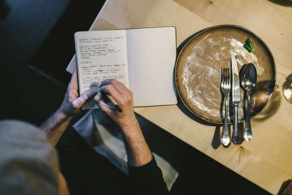 Food critic Florian Holzer making notes