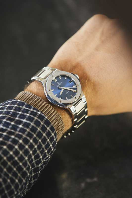 Jacket by Emporio Armani, jumper by Altea, watch by Hublot