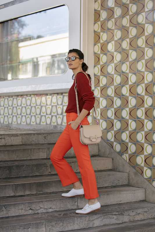 Jumper by Sunspel, trousers by Gucci, shoes by Santoni, sunglasses by Oliver Peoples, bag by Tod's