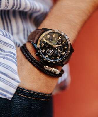 Shirt by Oliver Spencer, jeans by Prada, watch by Tag Heuer, bracelet by Tateossian