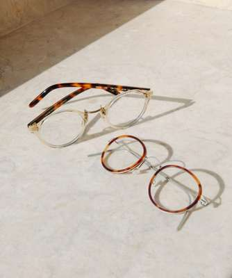 Glasses (left) by Oliver Peoples, (right) by Lindberg