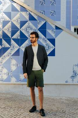 Jacket by Oliver Spencer,  jumper by Circolo 1901, shorts  by Goldwin, trainers by amb, glasses by Persol