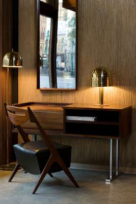 Desk by Haraldsøn Furniture Company and lamp by Pavo Tynell, Finland