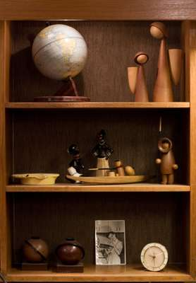 Products for sale including teak figures (top right) by Denmark's Basse, and kayak and Eskimo by Arne Tjomsland (middle shelf)