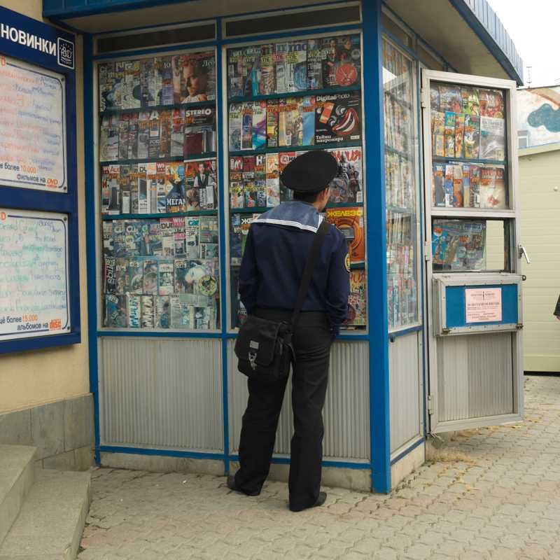 Sailor browses at a magazine kiosk