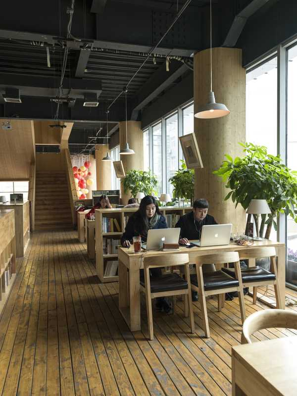 Locals work in the multi-functional café library in the Hi-Tech Development Zone
