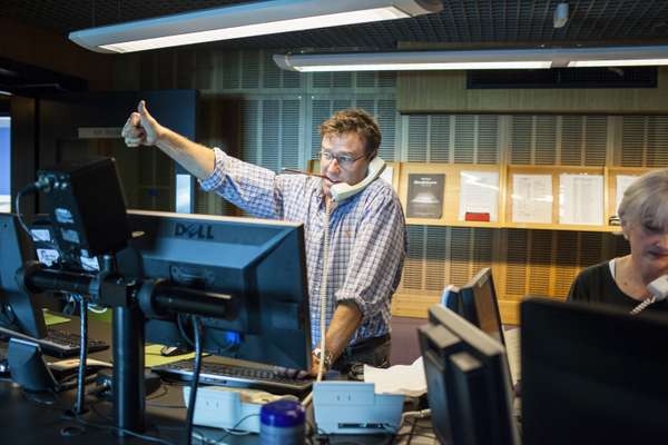 Producer Steven Turner gives the thumbs up from the control room at ABC Radio National