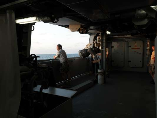 A crew member looks out to sea