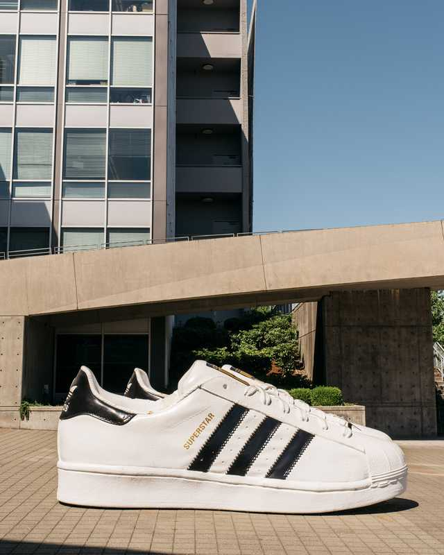 Giant pair of Superstar trainers, one of Adidas's signature models