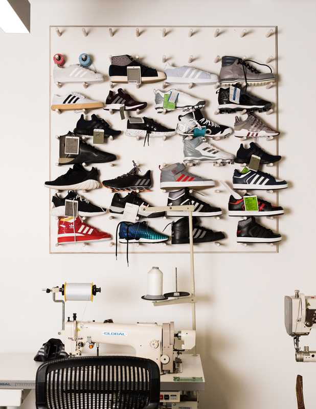 Wall of prototype sneakers in The MakerLab, a design studio in the Portland HQ