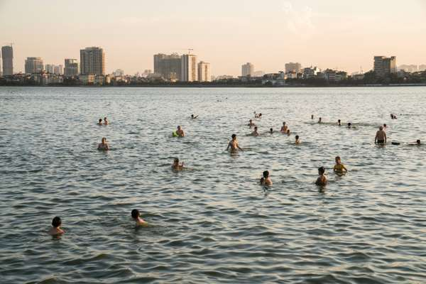 Hanoians swim in Tay Ho Lake