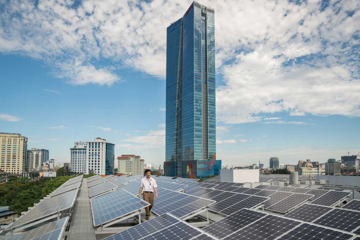 The roof of the newly built UN office is lined with solar panels and overlooks the Lotte skyscraper
