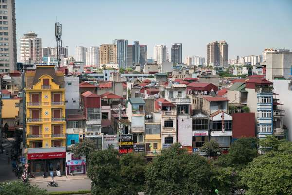 Residential buildings on Kim Ma Street in the shadow of the newly developed My Dinh area