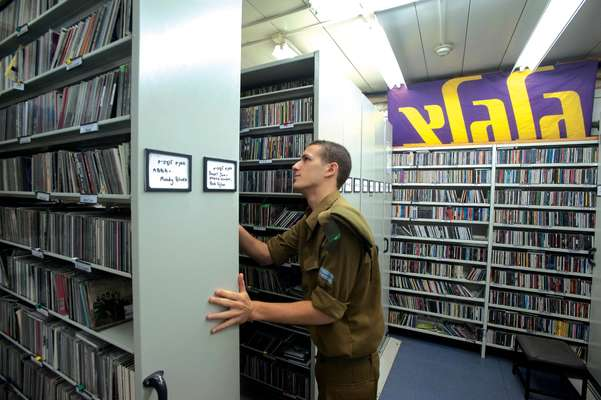 A soldier peruses the record library