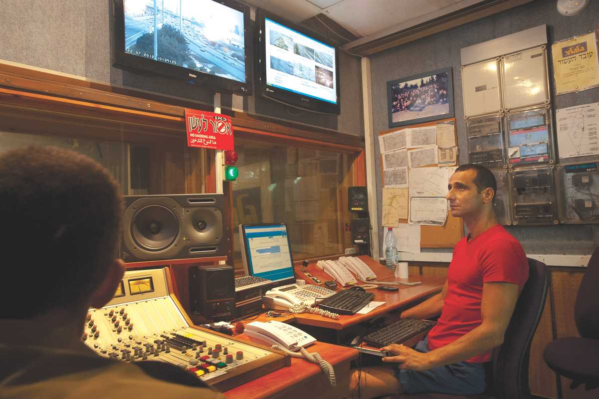 Benny Kevodi, chief transportation editor, in his studio