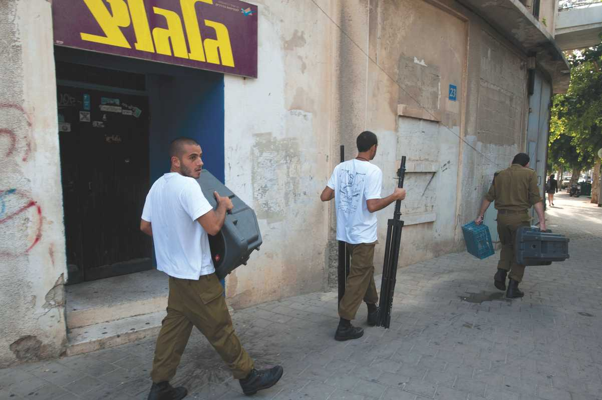 Israeli soldiers carrying audio equipment outside Galgalatz