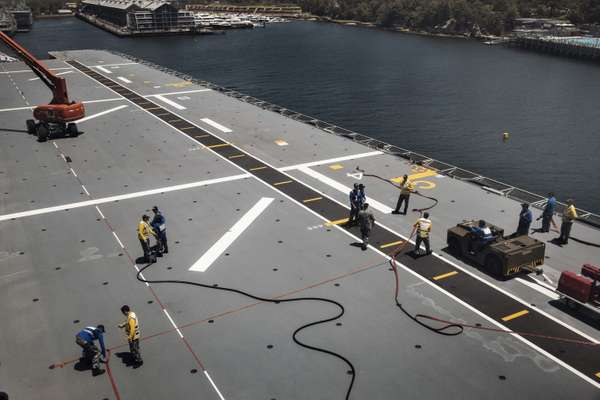 Crew members completing maintenance on the flight deck