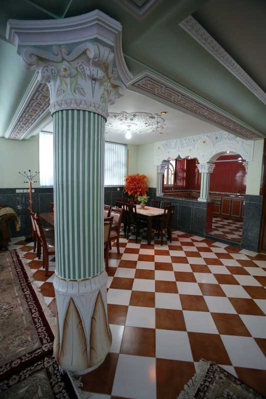 The basement in Hamkar's house has elaborate columns and plastic flowers