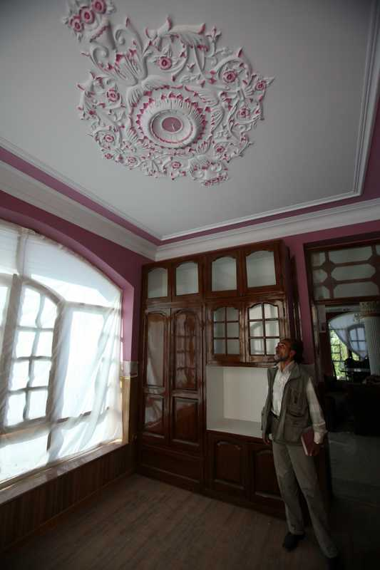 Architect Abdul Baki Garder inspects the work at one of the Nasiri mansions
