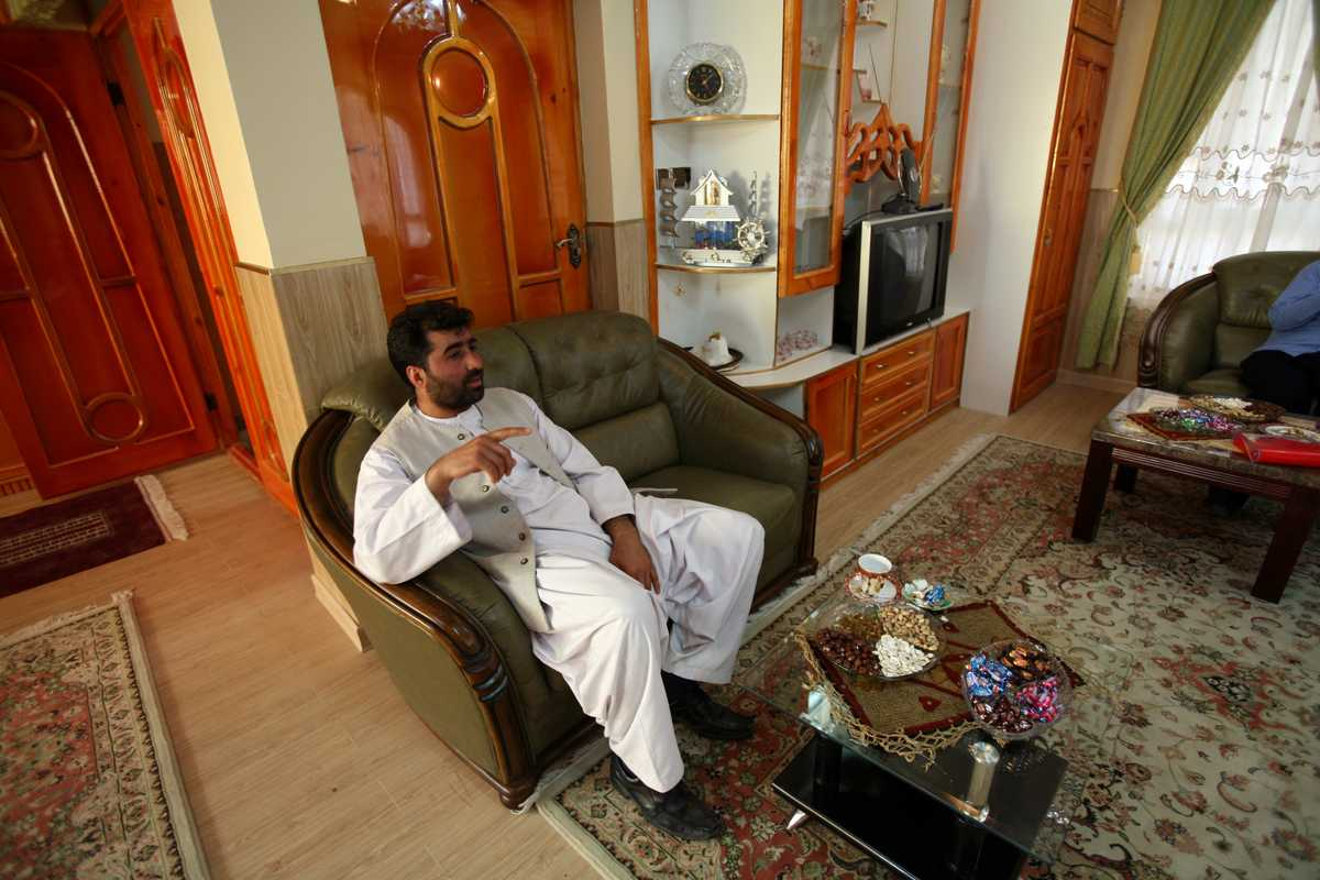 Nasiri in a finished room of one of the six new family houses