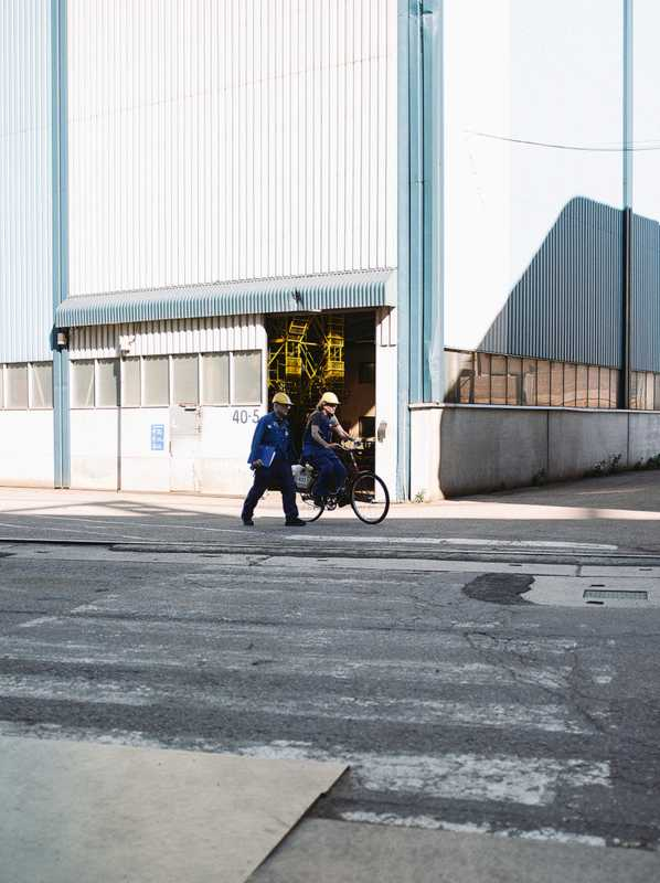 Some workers get around the vast Arctech site by bicycle