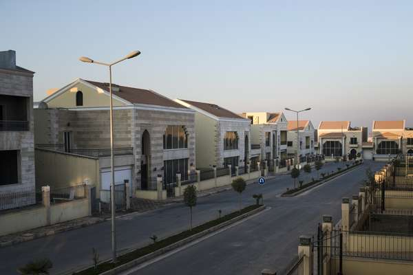 New housing complexes sit empty
