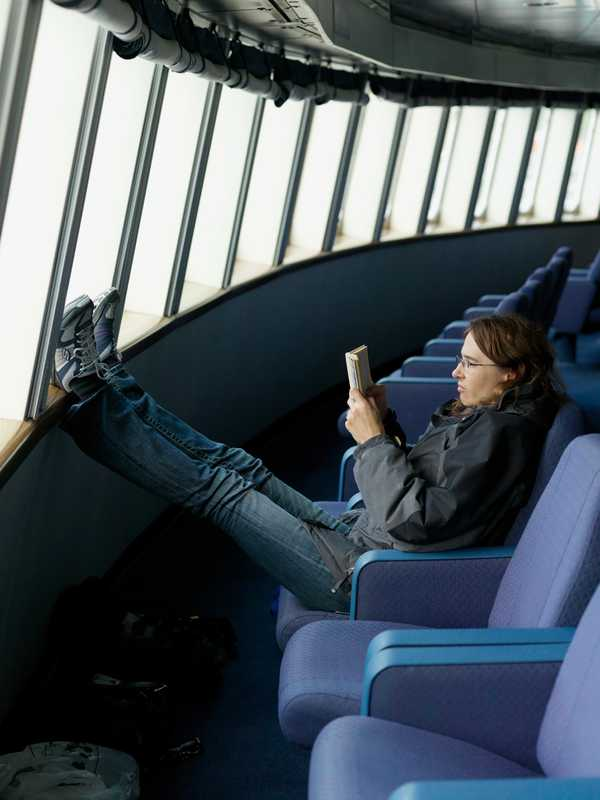 A passenger reads in the forward lounge