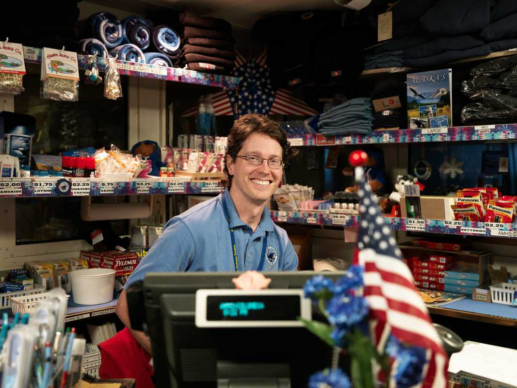 A deck steward in the ship's gift shop