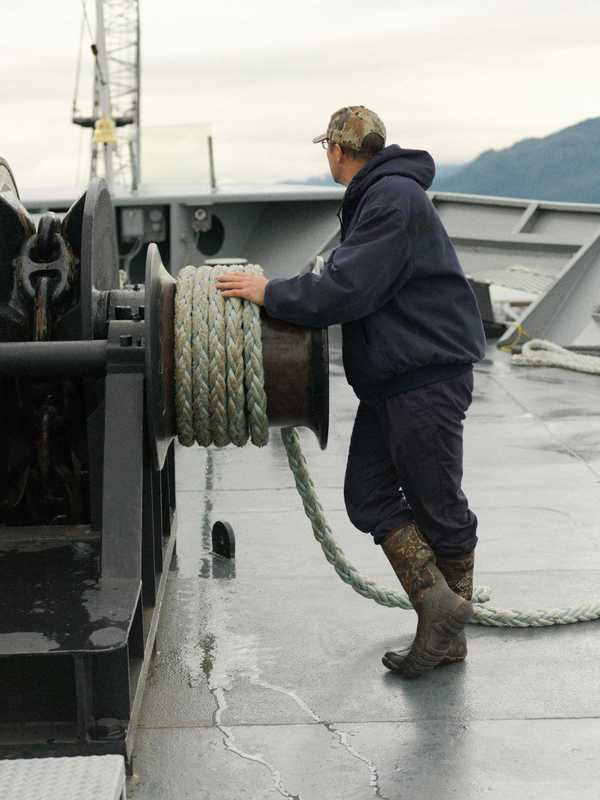A deck winch tightens Columbia's tie-up lines