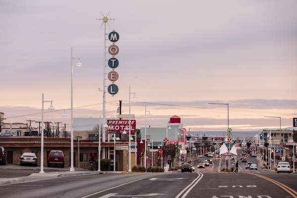 View towards Albuquerque along the  old Route 66, with some of its surviving neon motel signs