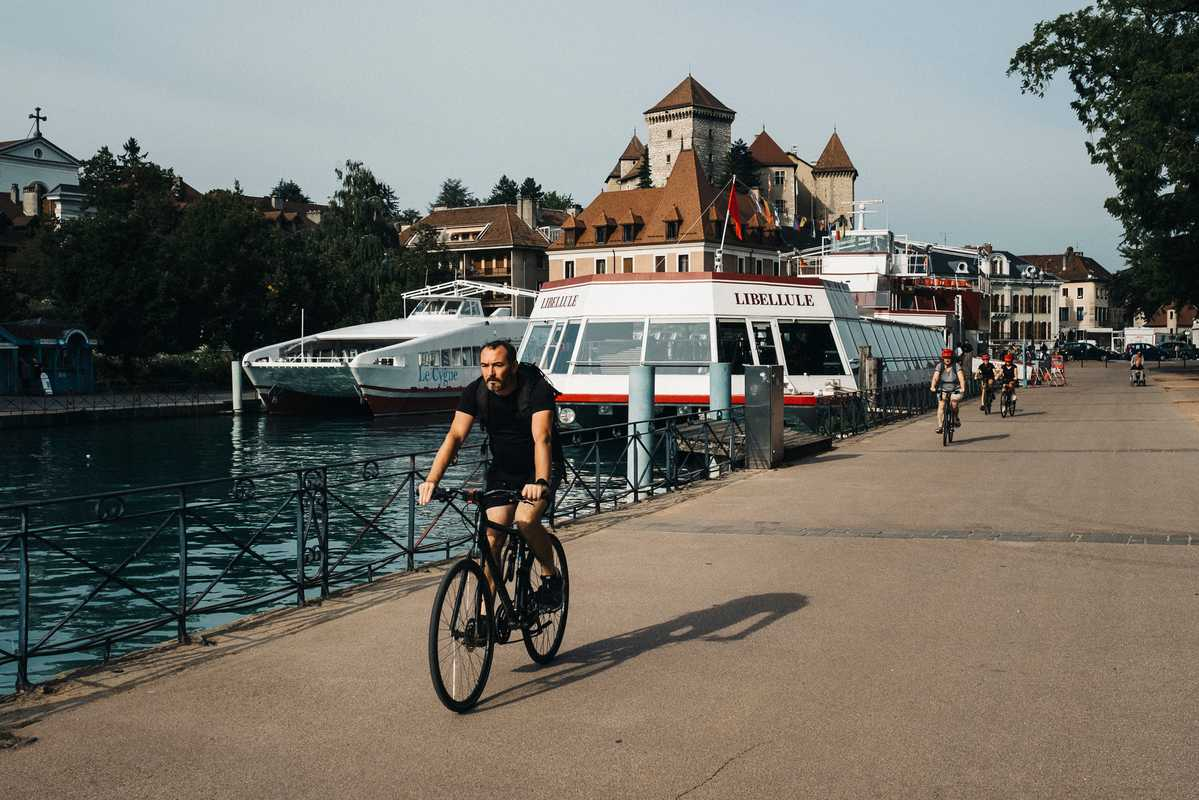 Cyclist besides Lake Annecy
