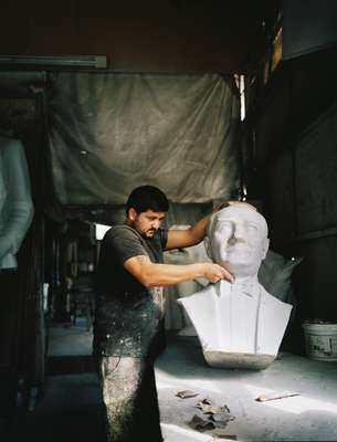 Studio worker preparing a bust of Ataturk
