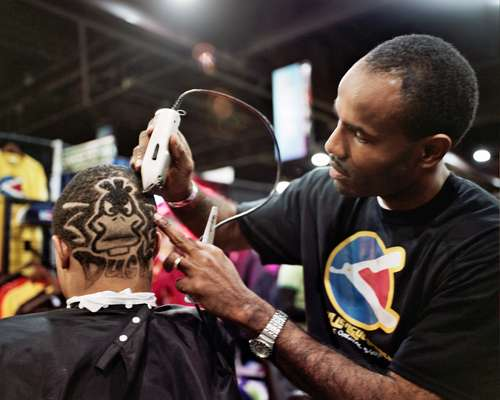 Major League Barber's King McLaurin shows off his razoring talents
