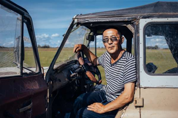 Hay harvester in his classic Soviet jeep UAZ near Byutyay Yurdya, 130km north of Yakutsk