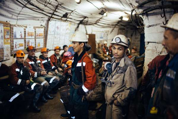 Miners waiting for a lift after their shift in International mine, 16km from Mirny