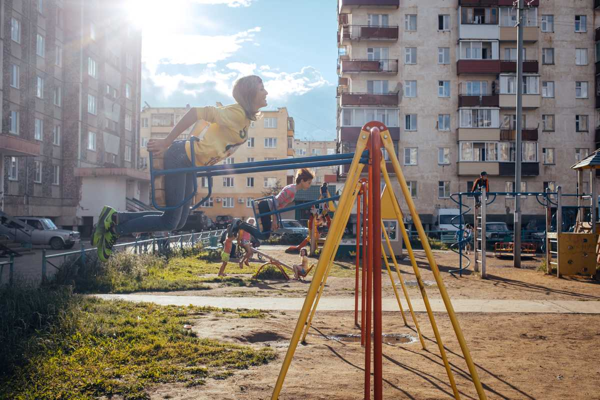 Children playing in a courtyard in Mirny