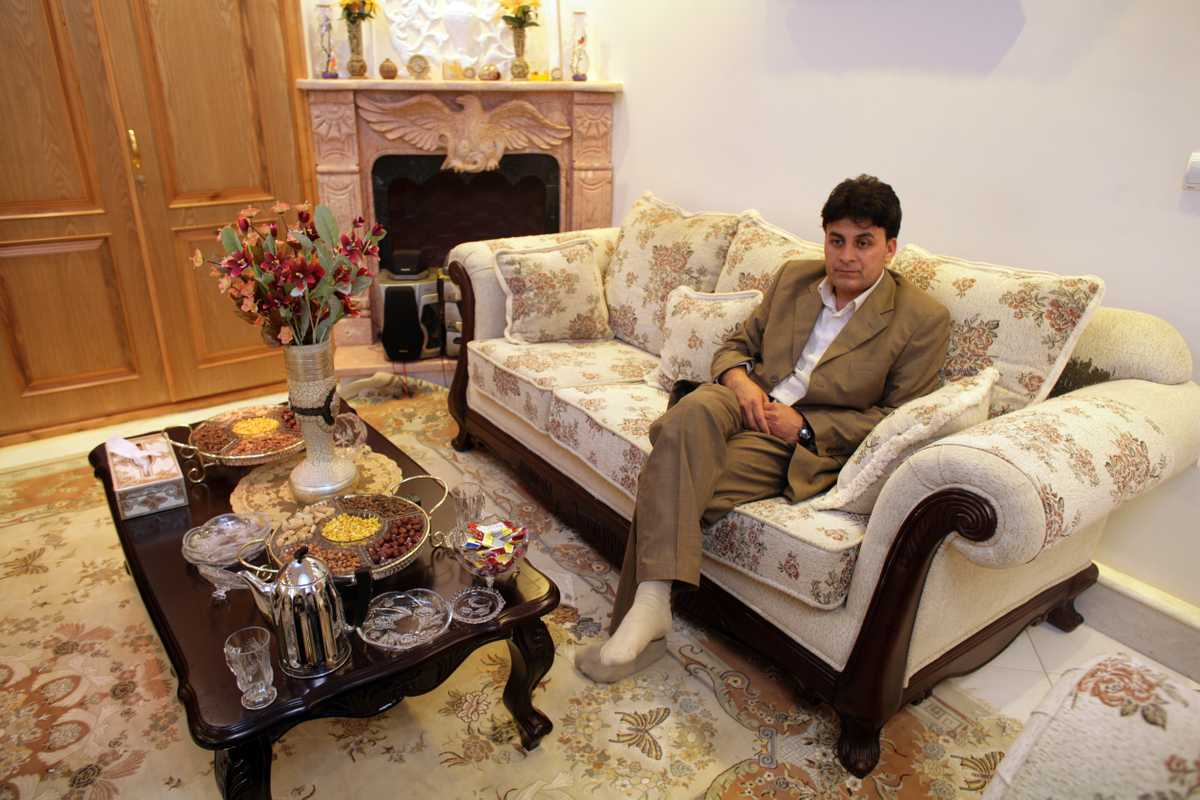 Faqiry, a legitimate local businessman, relaxes in his sitting room