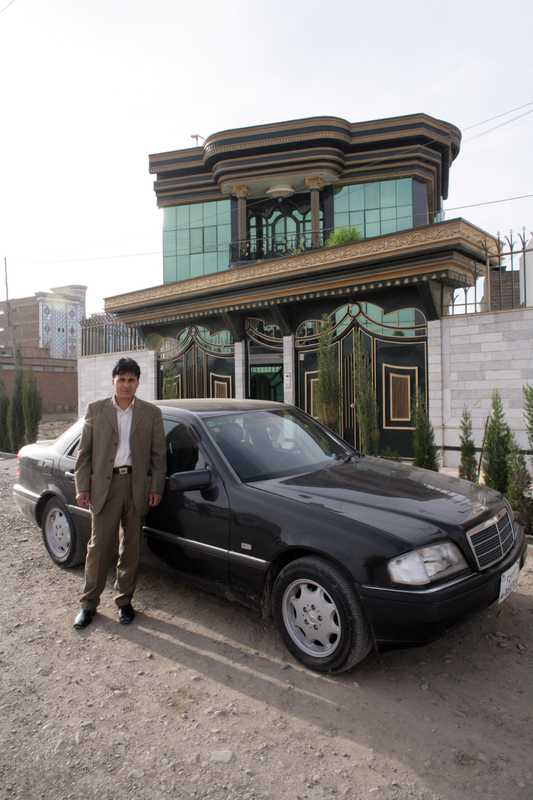 Mohammad Zaher Faqiry outside his almost complete mansion in Herat