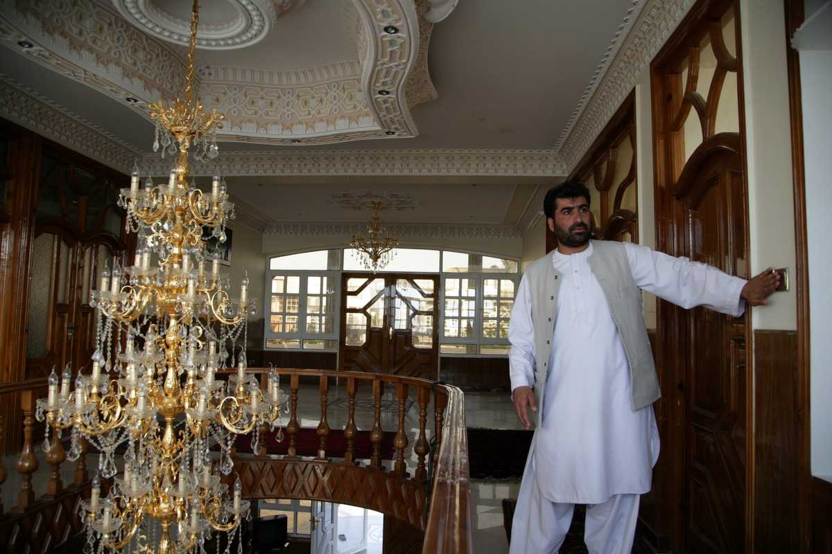 Habibullah Nasiri at his uncle's house with its two-metre-high Italian chandelier