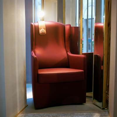 Luis armchair with reading lamp in Azucena showroom