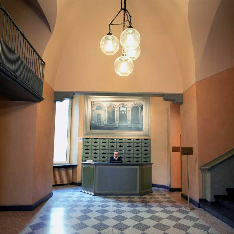 Boccia lamps are a common sigh in Milanese palazzos; seen here in the lobby of a building on Via Verdi