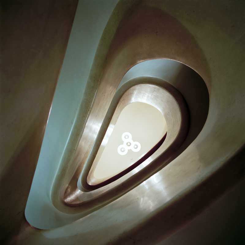 Skyward view of marble staircase at Teatro Filodrammatici